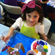 "Young girl participating in the ""Art & Juice"" Workshop presented by Raquel Torrent"