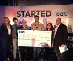 Drytunes Waterproof Speakers Crew accepts check for winning NOEW competition