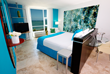 Luxury Bedroom of the Water Beach Club Hotel overlooking the beach in San Juan Puerto Rico