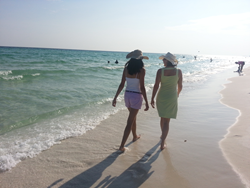 Mother and daughter spending quality time walking the beaches in Destin, Florida