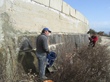 Completing repair work on the exterior of the Mornos Canal in Greece.