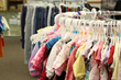 Children's clothing from Uptown Tots fills a rack at Clickstop Cares in Urbana.