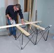 The included X-Cups are typically used in pairs to cradle standard 2x4s and create instant sawhorses.