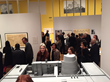 Museum-goers peruse architectural model