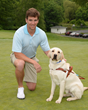 NY Giants Quarterback and nine-time Guiding Eyes for the Blind Golf Classic host Eli Manning with Guiding Eyes dog Jansen. Photo by: John Vecchiolla