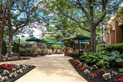 The Holiday Inn Westbury - Long Island Says Their Outdoor Garden Courtyard and Pool Area Bring Added Value to Their Property as Guests Enjoy a Unique Experience