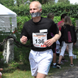 Anders Olsson running a half marathon with his mouth taped