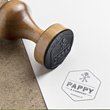 A stamp featuring the Pappy & Company logo
