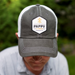 A hat featuring the Pappy & Company logo