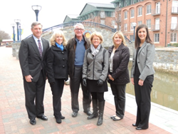 BB&T representatives and Community Foundation Trustees J. Ray Ramsburg, III (far left) and Colleen Chidester (far right) congratulate Bonnie Swanson, Jim Reinsch, and Lisa Collins (left to right, center), Color on the Creek representatives, and Angie Cast