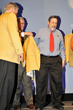 Michael Fuljenz receives his custom-tailored gold jacket at his induction into the NRA Golden Ring of Freedom society in Nashville, Tennessee on April 10, 2015.  (Photo by Jerry Jordan.)