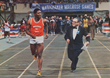Houston McTear (left) running for the Muhammad Ali Track Club (1976)