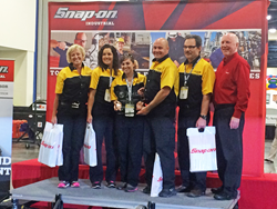 SLCC's winning aviation maintenance team (l-r) Gina Gottfredson Kelly, Rozie Nelson, Rachel Williams, Gary Driscoll and Scott Pugh with a Snap-on representative.