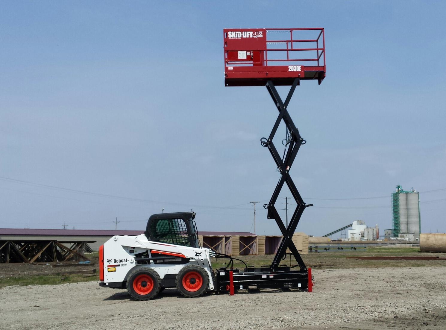 Tractor Bucket Hoist : Skid lift begins production of scissor attachments