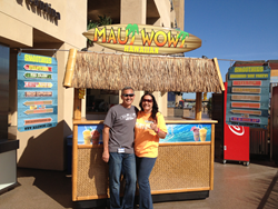 Ron and Barb Putman stand in front of their Maui Wowi cart, one many units the couple operates as franchisees and Directors of Regional Support.