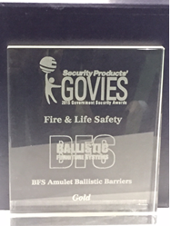 Lucite Gold Govies Award with etched Ballistic Furniture System's logo.
