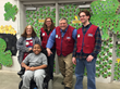 MDA Ambassador Torrance Johnson poses with employees from Lowe's store 734 in Ypsilanti, Mich. in front of their special MDA Shamrock display.