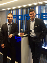Force Marketing COO and VP Randy Sieger and CEO and President John Fitzpatrick pose with the company's Pacesetter Award.