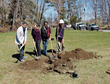 Arborist Russell Wagner from Almstead (right) with board members of the Hudson Gateway Chamber of Commerce planting an American Elm in Depew Park in Peekskill, NY