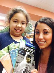 SAReads student receives books via the SAReads Book Bank.
