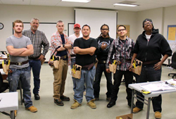 WECA Fast Track Trainees with their new toolbelts