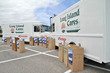 Purolator International Donates Two Trucks to Long Island Cares