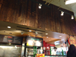 Pioneer Millworks' salvaged Mushroom Boards Patina and Circle Sawn grades were combined to create the soffit paneling at a grocery store in Illinois.