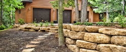 Retaining Walls Help Property with Flooding Problems