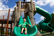 The custom treehouse with climbers and slides is accessible and completes the nature-themed design.