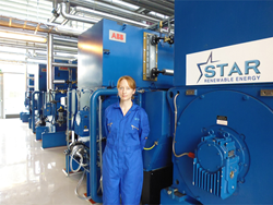 Sarah Patrick in front of Star Renewable Energy's heat pump in Drammen