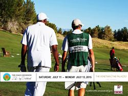 Coach Mike Woodson walks to the range with his caddy to warm up for the 2014 Coach Woodson Las Vegas Invitational at Southern Highlands Golf Club