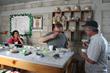Coffee Buyer Dave Eldridge (center) cups coffee