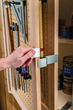 The two-layer door setup creates additional storage space where every inch counts in shops, craft rooms and garages.