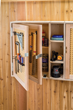 Using pegboard in the door panels effectively doubles the hanging storage capacity of cabinet doors.