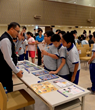 The local district police set up a booth where youth could ask questions and get additional information April 17, 2015 at the drug education open house at the Church of Scientology of Kaohsiung.