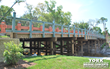 York Bridge Concepts™ (YBC) Timber Vehicular Bridges Revealed at Tampa's Premier Apartment Complex