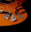 The J+H Guitar Pick Pendants