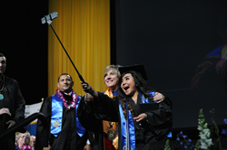 Justine Tabligan grabs a selfie with SLCC President Deneece G. Huftalin at Commencement Thursday.