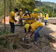A group of Scientology Volunteer Ministers help with the cleanup a village.