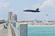 A Blue Angels solo pilot makes a high speed pass over the Pensacola Beach Gulf Pier, wowing thousands of spectators, during the Pensacola Beach Air Show.