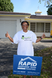 Got You Covered! Alfreda Echols is all smiles now that there's a new roof covering her home. Labor and materials were donated by Rapid Response Team Roofing and Rebuilding Together Broward.
