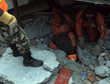 Los Topos at work, searching in the rubble of a collapsed building May 12, 2015, to ensure no one was trapped inside. Fortunately, they were able to confirm the building was empty when it collapsed.