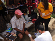 A Colombian paramedic from the CINAT organization is assisted by a Scientology Volunteer Minister in providing medical care May 12, 2015, for those injured by the earthquake.