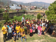 Some 40 children pose for a photo inside their orphanage near Kathmandu, Nepal, where they sang songs for Scientology Volunteer Ministers delivering food and toys as part of their relief mission.