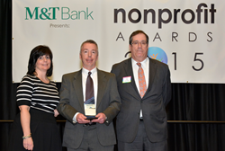 Kevin Morgan, president and CEO of ProLiteracy (center), named Executive of the Year at the 2015 Nonprofit Awards. He's pictured with Alissa Viti, charitable and community relations manager at M&T, and Tom Fiscoe, partner and CPA at Dannible & McKee, LLP.