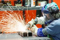 Cemen Tech employee grinding steel