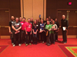 Nearly 20 Clickstop employees gather for a photo following the CBJ's 25 Fastest Growing Companies awards breakfast at the Coralville Marriott on Tuesday, May 19, 2015.