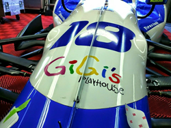 Down Syndrome Achievement Center GiGi's Playhouse Logo on #18 Car Driven by Carlos Huertas