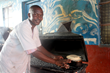Peter is from Kenya and works as a butcher, selling goat meat, raw or roasted, to support his family.