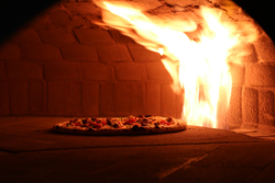Our custom rotating oven cooks pizza to crispy perfection in just 2 minutes